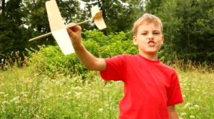 stock-footage-boy-is-holding-a-model-aircraft-in-his-hand-one-summer-day