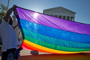 Supporters of same-sex marriage gathered at the Supreme Court on Tuesday as it heard arguments on whether to strike down bans on such marriages. Credit Stephen Crowley/The New York Times